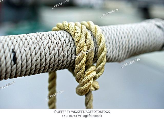 Select focus of ropes wrapped aound rail on fishing boat in Sitka, Alaska, USA