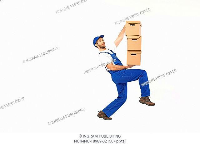 Funny picture of man holding paper boxes