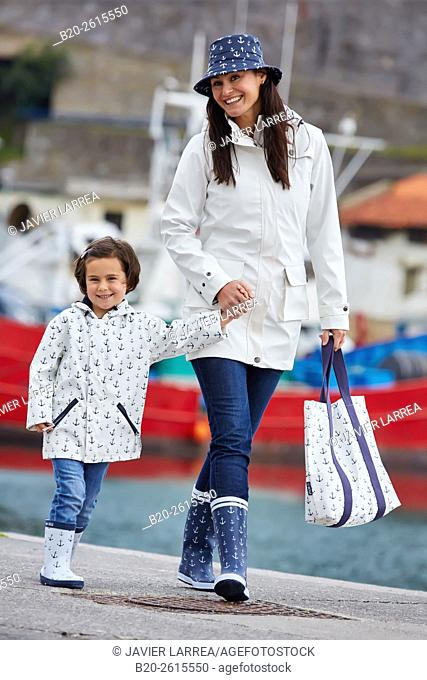 Mother and daughter in the fishing port. Getaria. Gipuzkoa. Basque Country. Spain