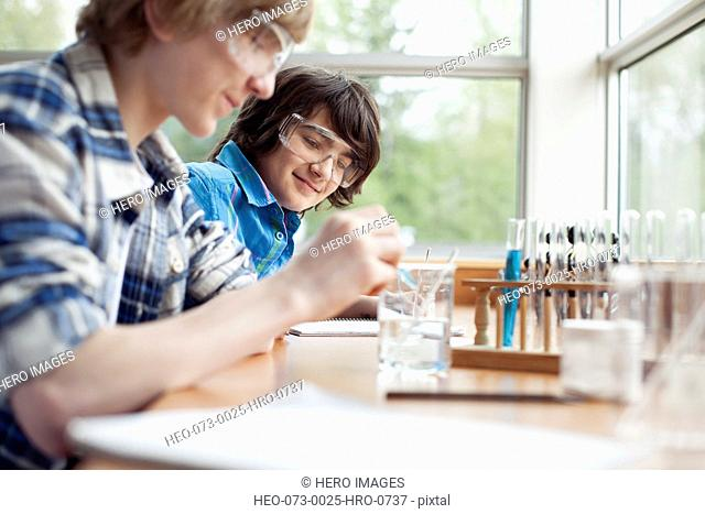 male, middle school students doing chemistry project