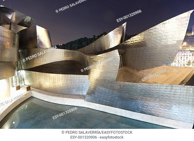 Bilbao, Biscay, Basque Country, Spain, July 30, 2011: night view of the Guggenheim Museum at sunset  Guggenheim Museum is dedicated exhibition of modern art and...
