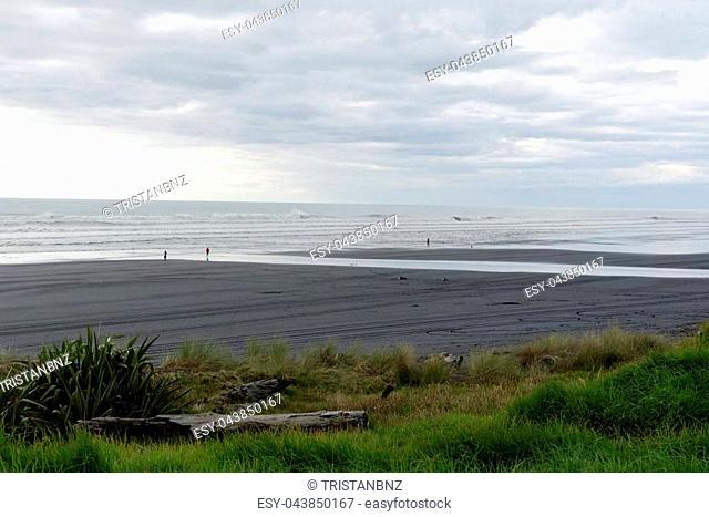 Black sand beach along the Taranaki coast, New Zealand