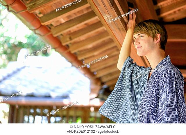 Caucasian man wearing yukata in traditional Japanese house