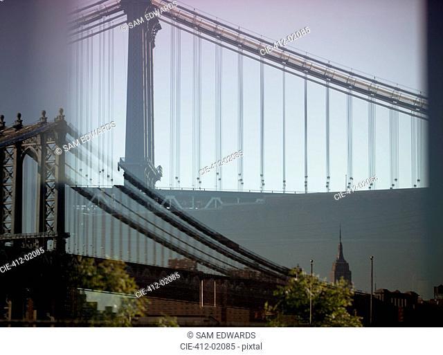 Double exposure image of urban bridge