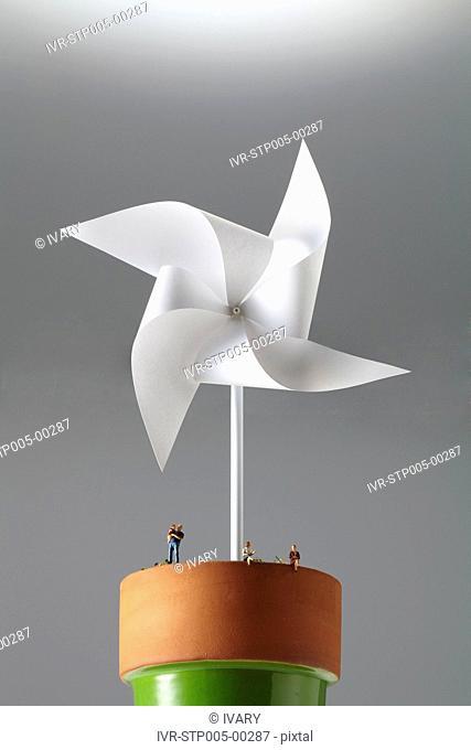 Pinwheel and small figurine in flowerpot