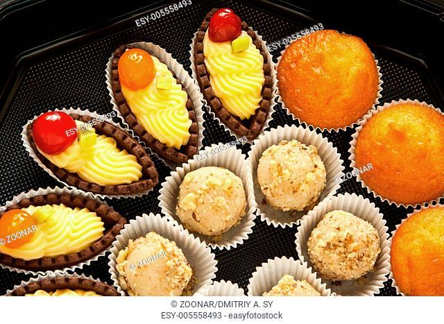 sweet mini tarts in black box
