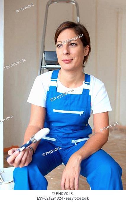 Female painter sat on ladder