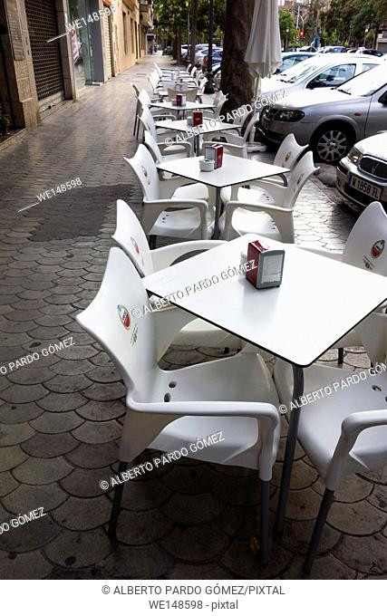 chairs and tables outside a cafe, valencia, Spain