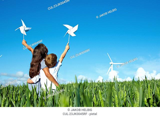 Boy and girl with wind turbine