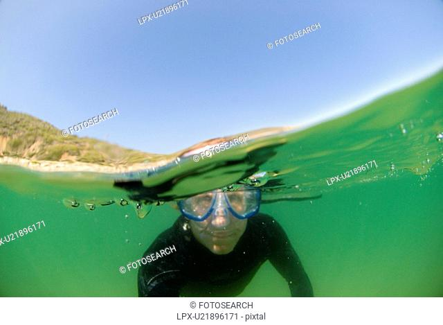 Man underwater with goggles on