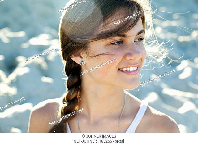 Teenage girl smiling on beach