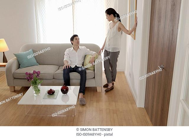 Couple discussing in living room