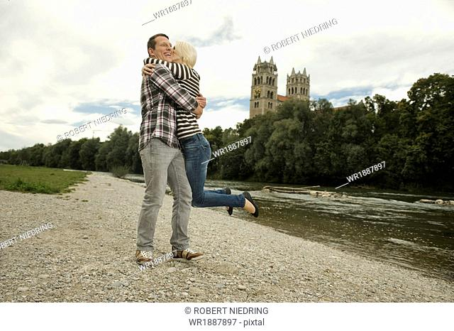 Young couple embracing outdoors, Munich, Bavaria, Germany
