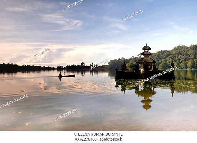 Outrigger canoe and temple on Lake Bratan; Bali
