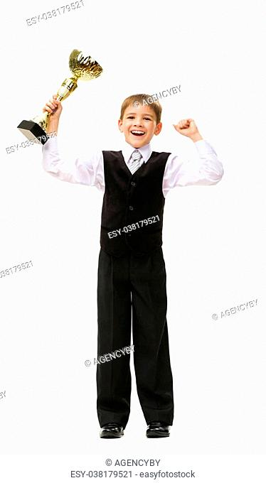 Full-length portrait of little businessman with gold cup, isolated on white. Concept of leadership and success