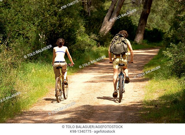 Cyclists in the Cami de Cavalls Fornells Bay Biosphere Reserve Menorca Balearic Islands Spain