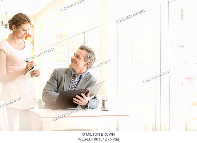 Man in restaurant placing the order