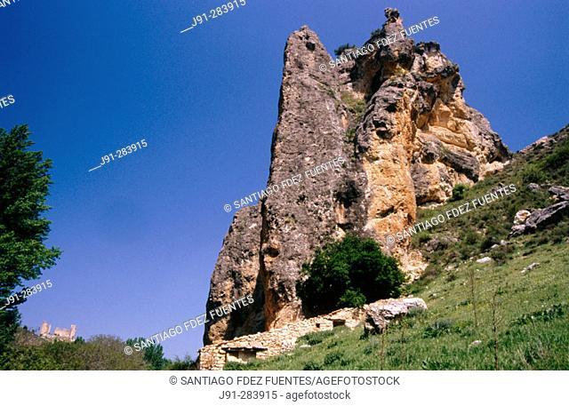Rock formation. At the back the castle of Pelegrina town. Hoces del Rio Dulce' (Rio Dulce Sickles). Guadalajara province. Spain