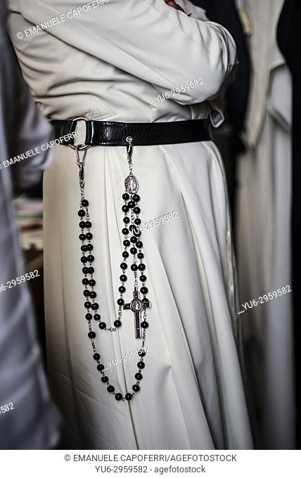 Dominican priest with Holy Rosary hanging on the belt
