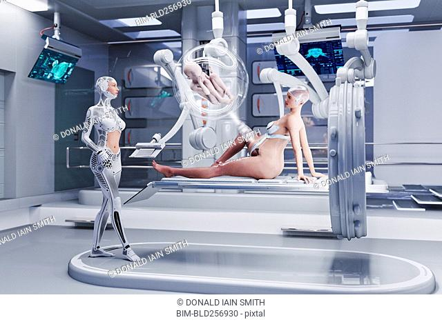 Futuristic nurses examining expectant mother