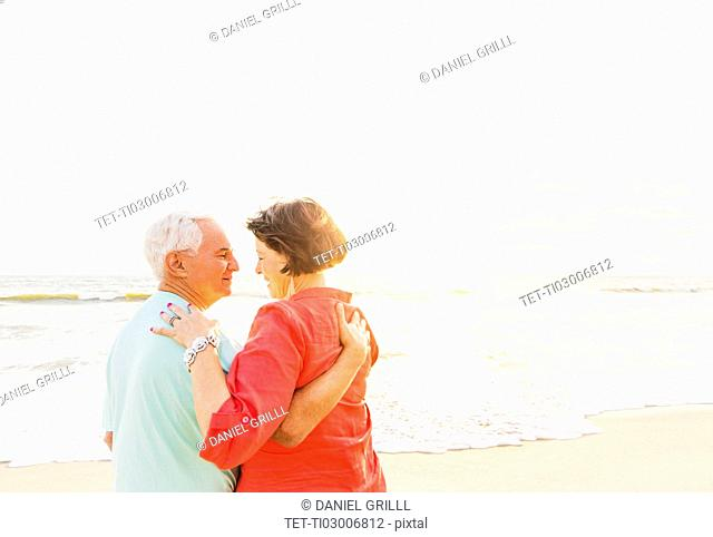Older couple spending time together on beach