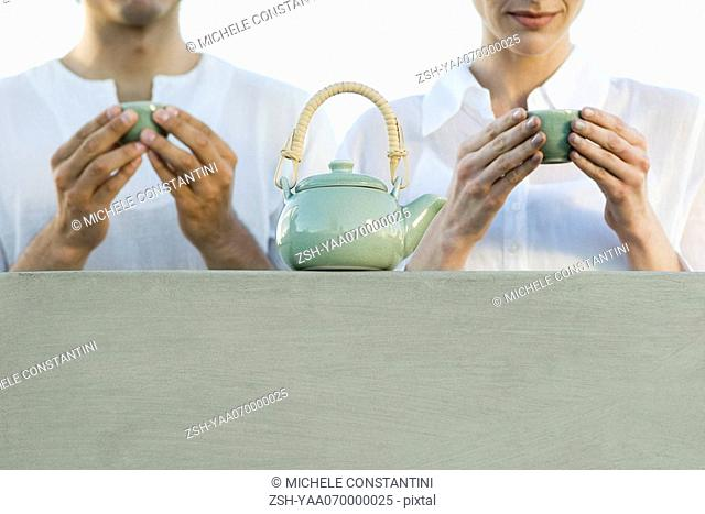 Man and woman having tea