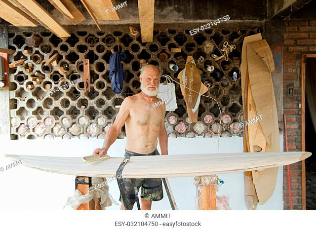 Old Man Making Balsa Surfboard In Ecuador