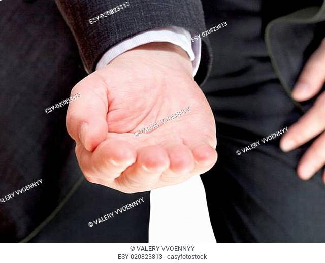 businessman holds handful - hand gesture