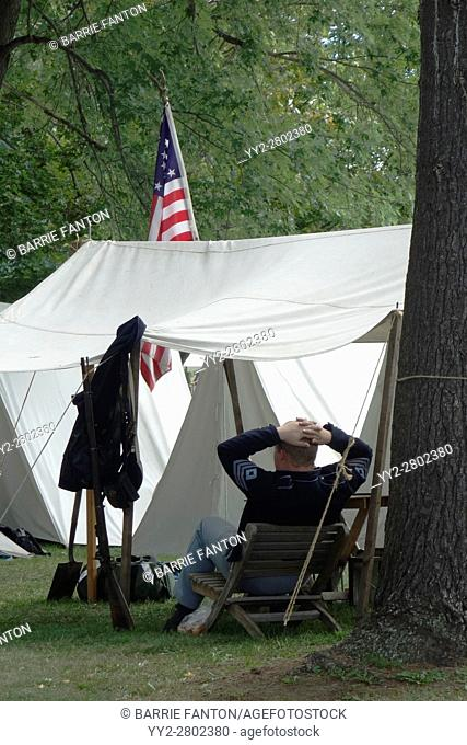 Reenactor Relaxing in Camp, Island Park, Wellsville, New York, USA