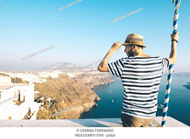 Greece, Santorini, Thira, man looking at view