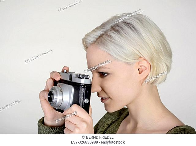 young woman with old camera