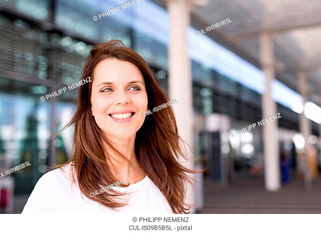 Businesswoman waiting outside airport
