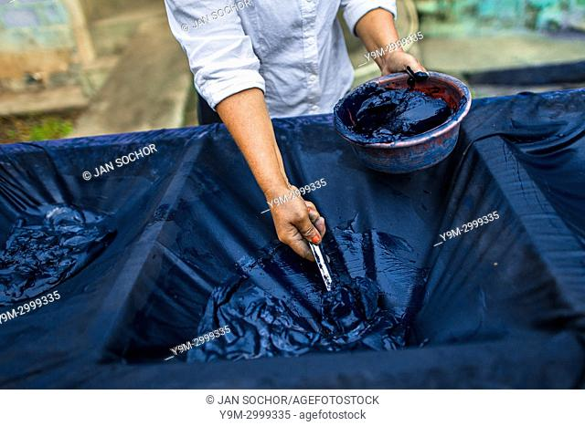 A Salvadoran farm worker collects indigo paste processed at the semi-industrial manufacture near San Miguel, El Salvador, 12 November 2016