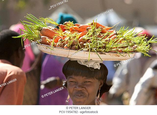 Vegetable vendor at the Monday Market, Djenne, Mali