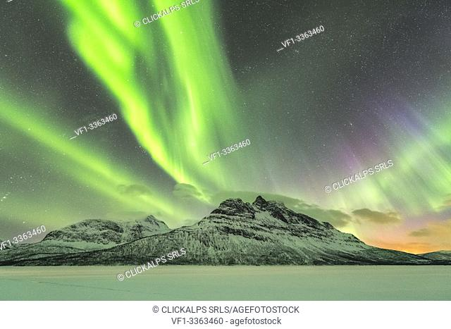 Northern lights in the sky above Skoddebergvatnet lake. Grovfjord, Troms county, Northern Norway, Norway