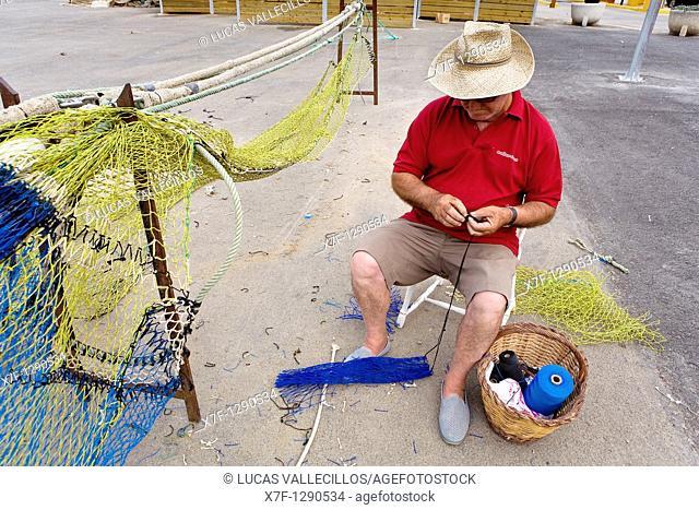 Palamós  Port  Fisherman sewing the networks  Costa Brava  Girona province  Catalonia  Spain