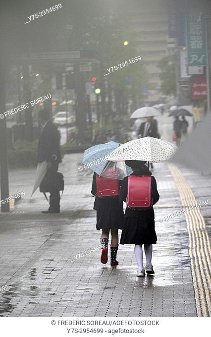 People with umbrellas walking in downtown Hiroshima,Hiroshima Prefecture, Japan,Asia