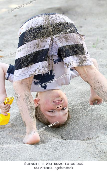 A boy playing at the beach in Liberty Lake, Washington, USA