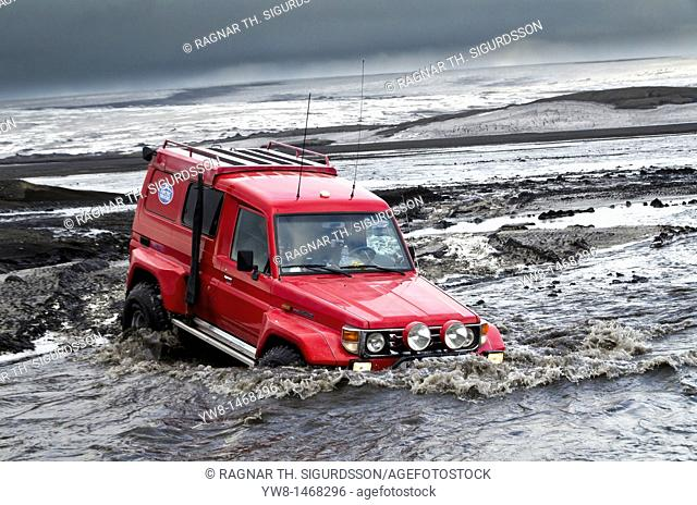 Big Red crossing the Tungnaa glacial river filled with ash from the Grimsvotn volcanic eruption, Iceland  Eruption began on May 21, 2011 spewing tons of ash