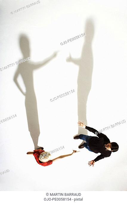 Woman pointing at man