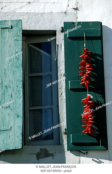 Espelette peppers hanging on a window shutter