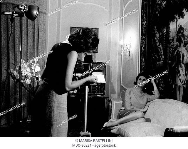 Sylva Koscina posing. Yugoslavian-born Italian actress Sylva Koscina sitting on the sofa in her house during a photo shooting. Rome, June 1963