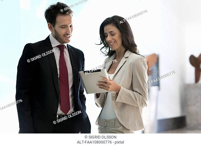 Business associates working together using digital tablet