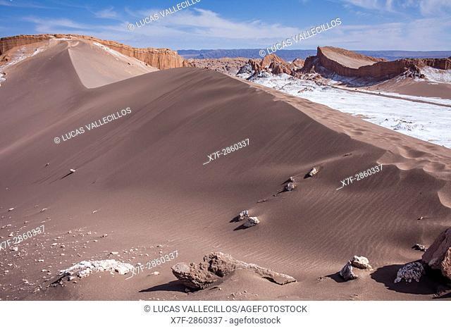 `Duna Mayor', in Valle de la Luna (Valley of the Moon ) and salt deposited on the ground, near San Pedro de Atacama, Atacama desert