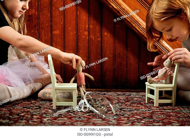 Girls playing on rug with toys