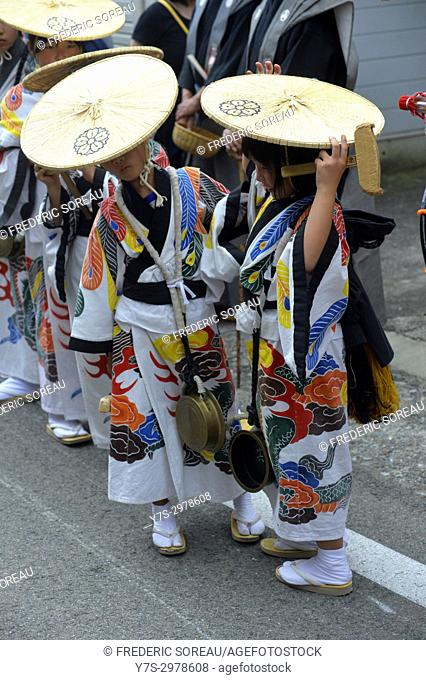 Young local dancers in traditional clothing during annual Takayama festival, one of the most famous festivals in Japan, Asia