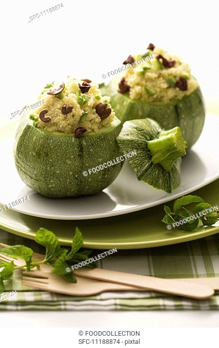 Courgettes with couscous and olive stuffing