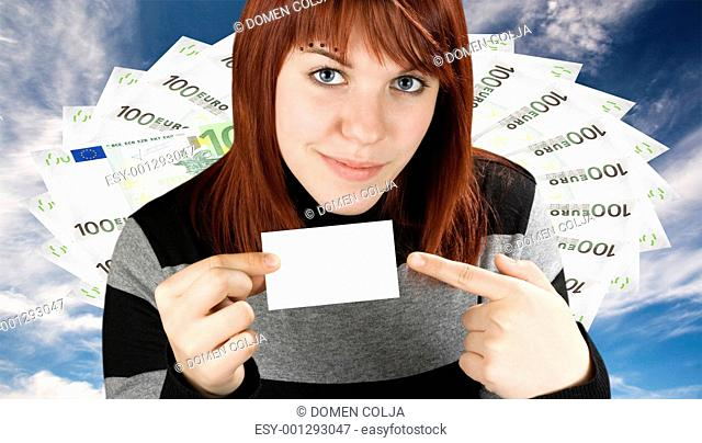 Girl pointing at a blank business card with a money background
