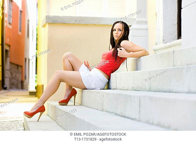 Young woman lying on a staircase