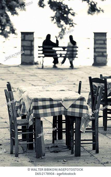 Greece, Thessaly Region, Makrinitsa, Pelion Peninsula, outdoor cafe tables with people